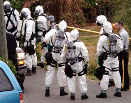 Armed members of the RCMP dressed in protective gear debrief after a raid on a suspected crystal meth lab in Nanaimo, British Columbia, Canada.