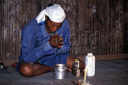 A Peruvian Shaman prays over ayuasca. The Shamans, or Paj�s (as they are known in Indian language), are not only the medicine men of the tribes and villages, but are also sorcerers and spiritual guides.