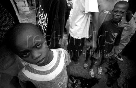 Haitian children let the curiosity get the best of them when stumbling upon our photographer in a slum named �Bel Aire� in Port au Prince.