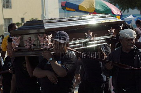 Family members and friends carry a casket through the streets of Pisco, Peru, South America.